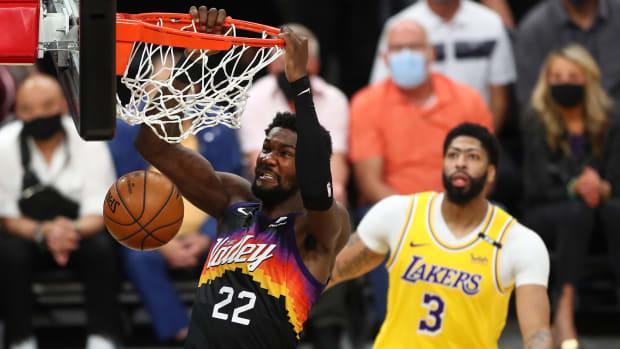 Phoenix Suns center Deandre Ayton dunks the ball against the Los Angeles Lakers