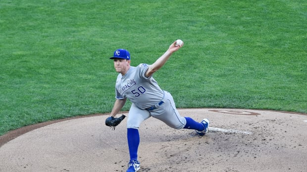 May 28, 2021; Minneapolis, Minnesota, USA; Kansas City Royals starting pitcher Kris Bubic (50) throws a pitch against the Minnesota Twins during the first inning at Target Field. Mandatory Credit: Jeffrey Becker-USA TODAY Sports