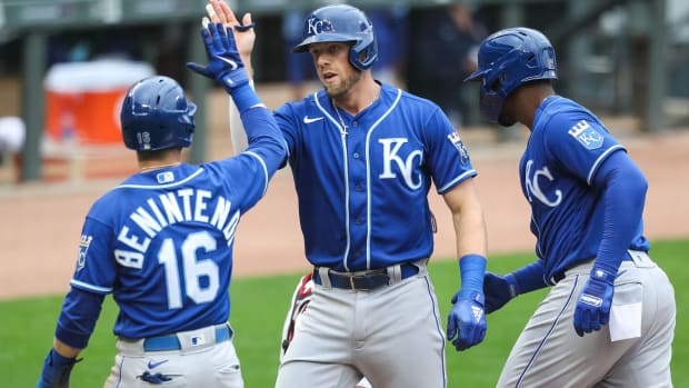 May 2, 2021; Minneapolis, Minnesota, USA; Kansas City Royals third baseman Hunter Dozier (17) celebrates with left fielder Andrew Benintendi (16) and right fielder Jorge Soler (12) after Dozier hit a three-run home run against the Minnesota Twins in the fourth inning at Target Field. Mandatory Credit: David Berding-USA TODAY Sports