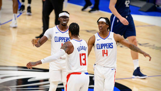 May 28, 2021; Dallas, Texas, USA; LA Clippers guard Paul George (13) and guard Terance Mann (14) celebrate during the second quarter against the Dallas Mavericks in game three in the first round of the 2021 NBA Playoffs at American Airlines Center. Mandatory Credit: Jerome Miron-USA TODAY Sports