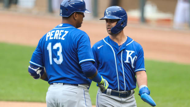 May 30, 2021; Minneapolis, Minnesota, USA; Kansas City Royals second baseman Whit Merrifield (15) celebrates with catcher Salvador Perez (13) after scoring a run against the Minnesota Twins in the first at Target Field. Mandatory Credit: David Berding-USA TODAY Sports