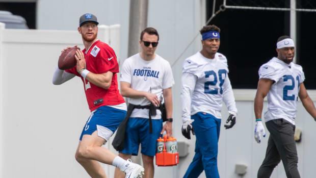 May 27, 2021; Indianapolis, Indiana, USA; Indianapolis Colts quarterback Carson Wentz (2) throws the ball during Indianapolis Colts OTAs.