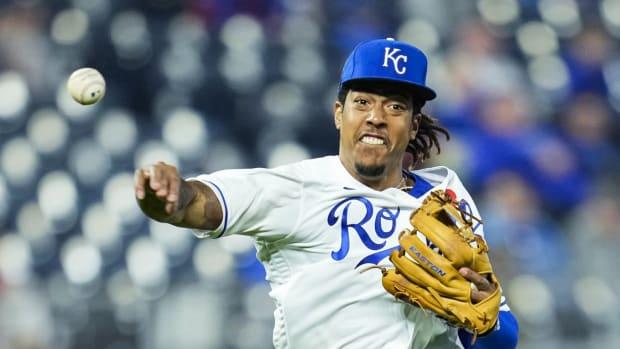 May 31, 2021; Kansas City, Missouri, USA; Kansas City Royals shortstop Adalberto Mondesi (27) throws to first base against the Pittsburgh Pirates during the eighth inning at Kauffman Stadium. Mandatory Credit: Jay Biggerstaff-USA TODAY Sports