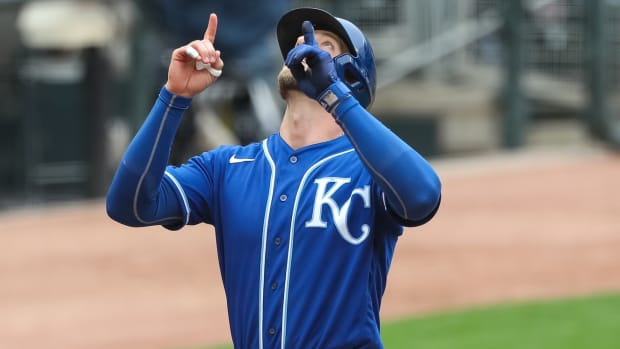 May 30, 2021; Minneapolis, Minnesota, USA; Kansas City Royals designated hitter Hunter Dozier (17) celebrates after hitting a solo home run against the Minnesota Twins in the ninth inning at Target Field. Mandatory Credit: David Berding-USA TODAY Sports