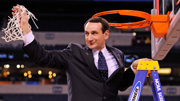 Duke's Mike Krzyzewski holds up the net after the 2010 national championship
