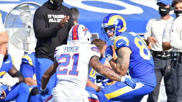 Los Angeles Rams tight end Tyler Higbee (89) faces off against Buffalo Bills free safety Jordan Poyer (21).