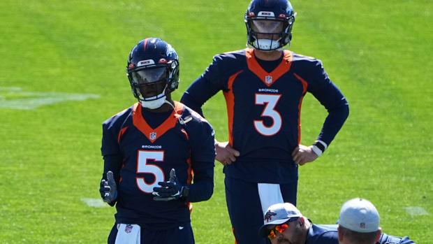 Denver Broncos quarterback Teddy Bridgewater (5) and quarterback Drew Lock (3) during organized team activities at the UCHealth Training Center.