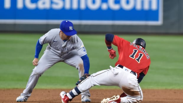 May 28, 2021; Minneapolis, Minnesota, USA; Kansas City Royals second basement Whit Merrifield (15) applies the tag to Minnesota Twins second basemen Jorge Polanco (11) after Polanco hit a double during the ninth inning at Target Field. Mandatory Credit: Jeffrey Becker-USA TODAY Sports