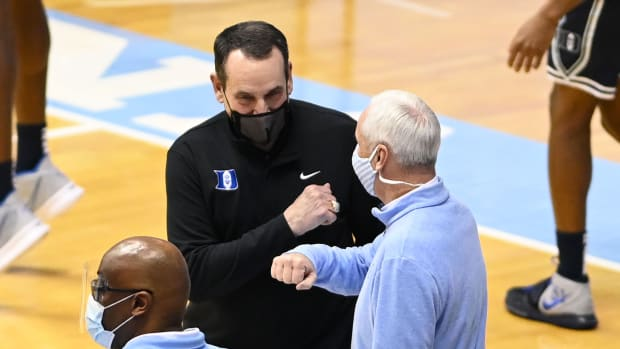 Coach K and Roy Williams first bump