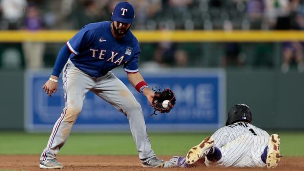 Jun 2, 2021; Denver, Colorado, USA; Colorado Rockies shortstop Garrett Hampson (1) steals second against Texas Rangers shortstop Isiah Kiner-Falefa (9) in the eighth inning at Coors Field.