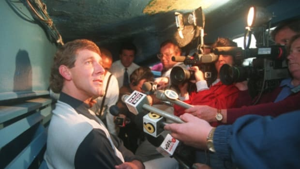 Tigers closer Mike Henneman, the team's union player rep, speaks to the media in the dugout in Tiger Stadium on Aug. 11, 1994, the last day before the players strike. Henneman Talks