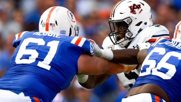 Oct 5, 2019; Gainesville, FL, USA; Auburn Tigers defensive tackle Derrick Brown (5) rushes the passer as Florida Gators offensive lineman Brett Heggie (61) defends during the second quarter at Ben Hill Griffin Stadium.