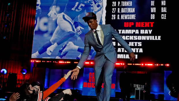 Gregory Rousseau (Miami) walks on stage after being selected by the Buffalo Bills as the number 30 overall pick in the first round of the 2021 NFL Draft at First Energy Stadium