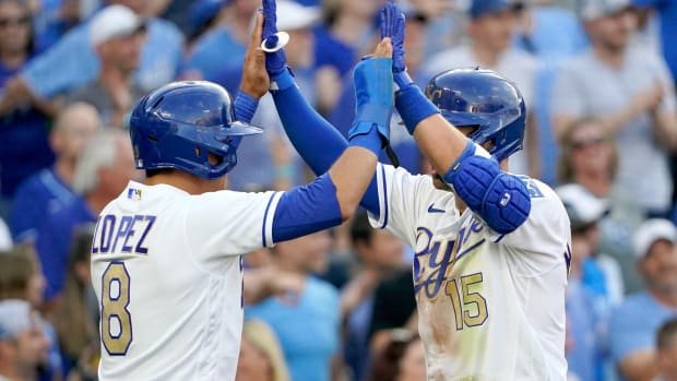 Jun 4, 2021; Kansas City, Missouri, USA; Kansas City Royals second baseman Whit Merrifield (15) celebrates with shortstop Nicky Lopez (8) after after hitting a two run home run in the first inning against the Minnesota Twins at Kauffman Stadium. Mandatory Credit: Denny Medley-USA TODAY Sports