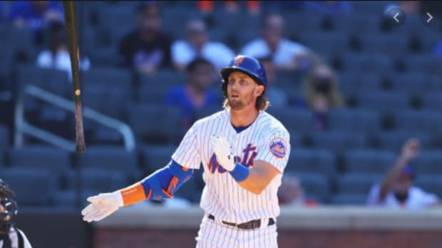 Mets' Jeff McNeil flips his bat after a huge game-tying homer in the 9th