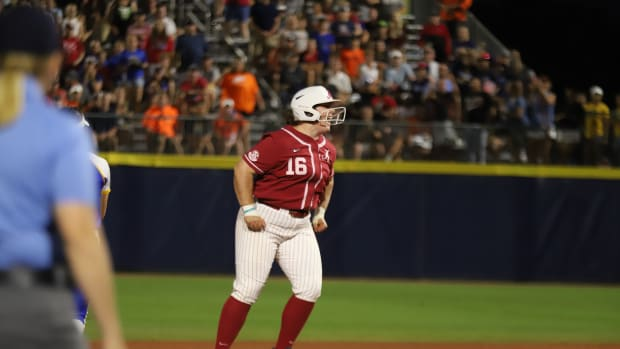 Bailey Hemphill celebrates her RBI double in the first inning against UCLA in the WCWS on June 3, 2021