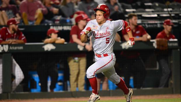 Joe Acker runs home to score the only run for Nebraska.