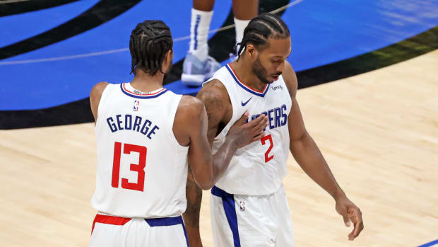 Jun 4, 2021; Dallas, Texas, USA; LA Clippers forward Kawhi Leonard (2) celebrates with guard Paul George (13) during the fourth quarter against the Dallas Mavericks during game six in the first round of the 2021 NBA Playoffs at American Airlines Center. Mandatory Credit: Kevin Jairaj-USA TODAY Sports