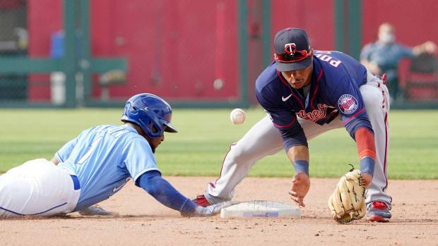 Jun 5, 2021; Kansas City, Missouri, USA; Minnesota Twins second baseman Jorge Polanco (11) misses the throw at second base as Kansas City Royals center fielder Jarrod Dyson (1) dives back in the ninth inning at Kauffman Stadium. Mandatory Credit: Denny Medley-USA TODAY Sports