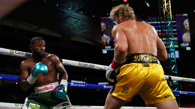 Logan Paul and Floyd Mayweather during an exhibition boxing match in Miami.