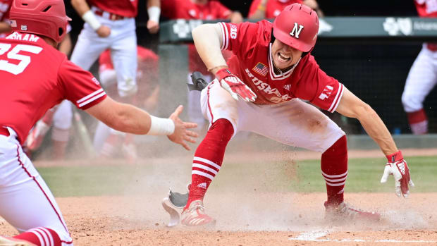 Cam Chick celebrates his three-run inside-the-park home run vs NJIT baseball 2021