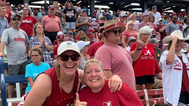 Alabama softball super fan Emily Pitek, left, with Colleen Cornell, mother of Crimson Tide pitcher Sarah Cornell