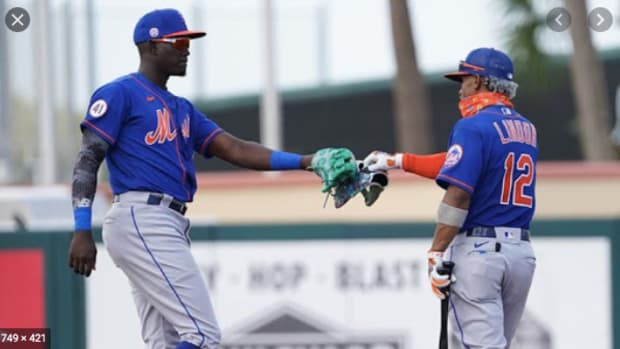 Mets shortstop of the present Francisco Lindor fist bumps shortstop of the future Ronnie Mauricio