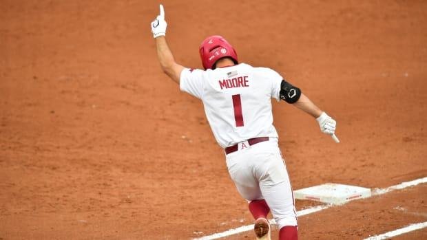 Arkansas' Robert Moore celebrates his game-tying home run (2)