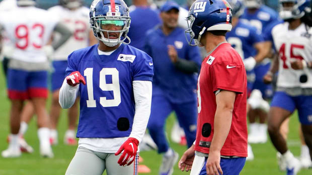 New York Giants wide receiver Kenny Golladay (19) and quarterback Daniel Jones (8) talk during OTA practice at the Quest Diagnostics Training Center on Friday, June 4, 2021, in East Rutherford.