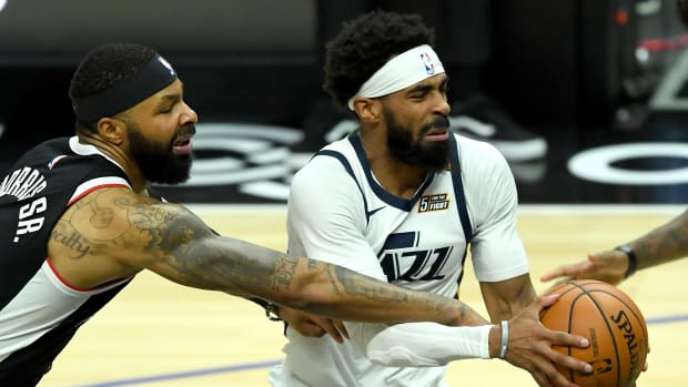 Feb 19, 2021; Los Angeles, California, USA; Los Angeles Clippers forward Marcus Morris Sr. (8) defends Utah Jazz guard Mike Conley (10) as he drives to the basket in the second half of the game at Staples Center. Mandatory Credit: Jayne Kamin-Oncea-USA TODAY Sports