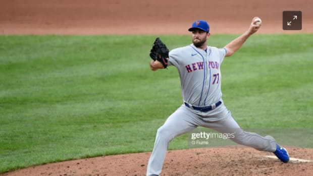 New York Mets lefty David Peterson fires a pitch home against the Baltimore Orioles