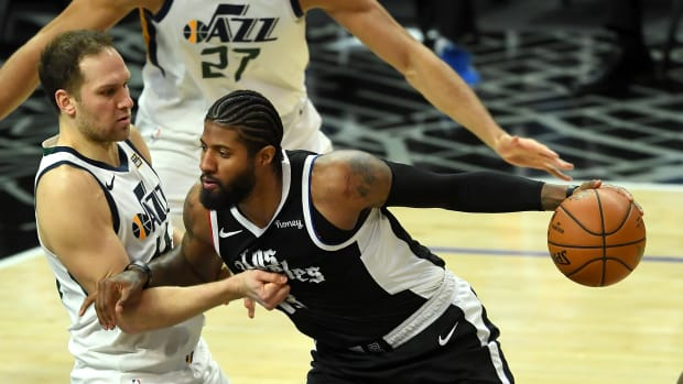 Feb 19, 2021; Los Angeles, California, USA; Utah Jazz forward Bojan Bogdanovic (44) defends Los Angeles Clippers guard Paul George (13) as he drives to the basket in the second half of the game at Staples Center. Mandatory Credit: Jayne Kamin-Oncea-USA TODAY Sports