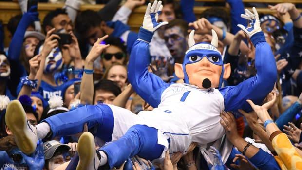 Duke Blue Devils mascot crowd surfs during the first half against the North Carolina Tar Heels at Cameron Indoor Stadium.