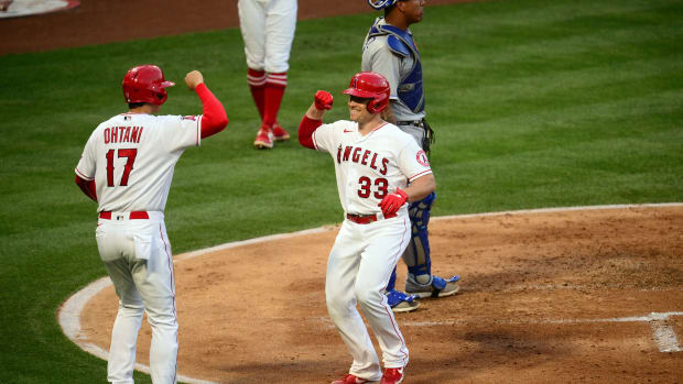 Jun 8, 2021; Anaheim, California, USA; Los Angeles Angels catcher Max Stassi (33) is greeted by designated hitter Shohei Ohtani (17) after hitting a two run home run against the Kansas City Royals during the third inning at Angel Stadium. Mandatory Credit: Gary A. Vasquez-USA TODAY Sports