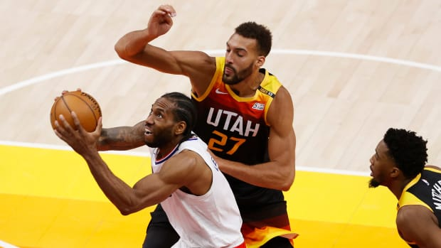 Jun 8, 2021; Salt Lake City, Utah, USA; LA Clippers forward Kawhi Leonard (2) drives to the hoop against Utah Jazz center Rudy Gobert (27) in the fourth quarter during game one in the second round of the 2021 NBA Playoffs. at Vivint Arena. Mandatory Credit: Jeffrey Swinger-USA TODAY Sports