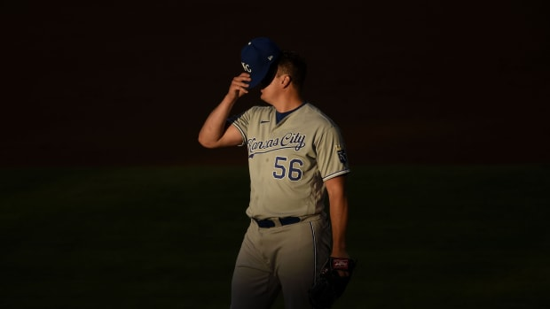 Jun 9, 2021; Anaheim, California, USA; Kansas City Royals starting pitcher Brad Keller (56) puts on his hat during the second inning against the Los Angeles Angels at Angel Stadium. Mandatory Credit: Kelvin Kuo-USA TODAY Sports