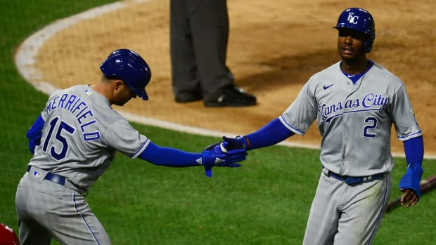 Jun 8, 2021; Anaheim, California, USA; Kansas City Royals center fielder Michael A. Taylor (2) is greeted by second baseman Whit Merrifield (15) after scoring a run against the Los Angeles Angels during the seventh inning at Angel Stadium. Mandatory Credit: Gary A. Vasquez-USA TODAY Sports