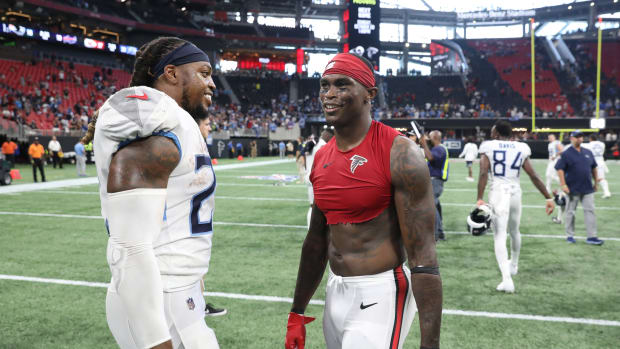ennessee Titans running back Derrick Henry (22) talks with Atlanta Falcons wide receiver Julio Jones (11) after their game at Mercedes-Benz Stadium.