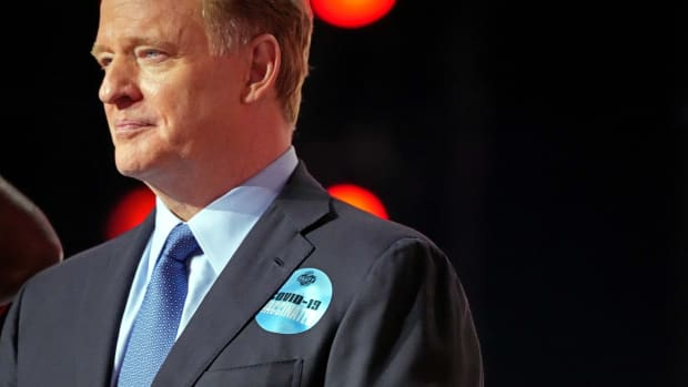 """NFL commissioner Roger Goodell wears a sticker that reads """"COVID-19 Vaccinated"""" in the first round of the 2021 NFL Draft at First Energy Stadium."""