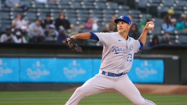 Jun 10, 2021; Oakland, California, USA; Kansas City Royals pitcher Mike Minor (23) pitches the ball against the Oakland Athletics during the second inning at RingCentral Coliseum. Mandatory Credit: Kelley L Cox-USA TODAY Sports