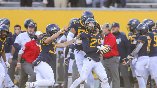 Nov 14, 2020; Morgantown, West Virginia, USA; West Virginia Mountaineers safety Sean Mahone (29) celebrates with teammates after recovering a fumble during the third quarter during the fourth quarter against the TCU Horned Frogs at Mountaineer Field at Milan Puskar Stadium.
