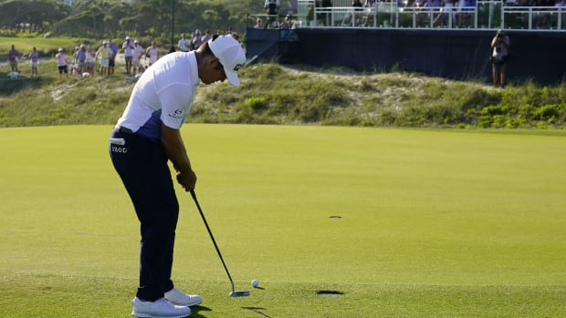 Louis Oosthuizen putts for eagle at the 16th green during the PGA Championship's final round at Kiawah Island Resort's Ocean Course on May 23, 2021.