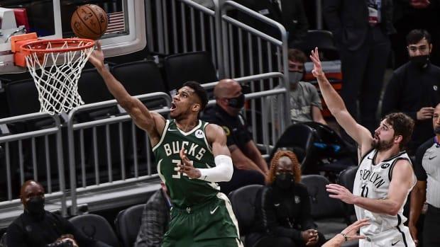Milwaukee Bucks' Giannis Antetokounmpo and Brooklyn Nets' Joe Harris