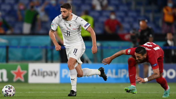 Domenico Berardi of Italy gets away from Umut Meras of Turkey during the UEFA Euro 2020 Championship Group A match between Turkey and Italy at the Stadio Olimpico on June 11, 2021 in Rome, Italy.