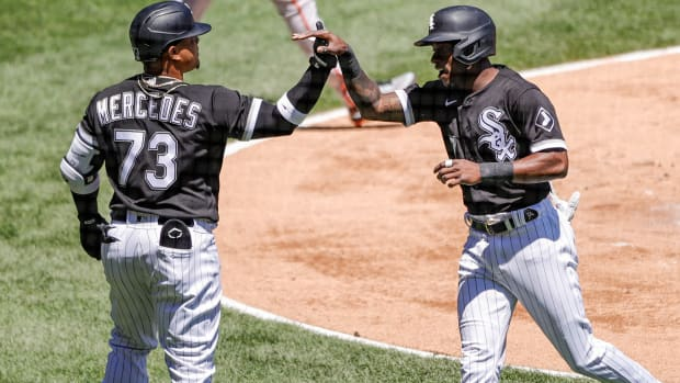 May 29, 2021; Chicago, Illinois, USA; Chicago White Sox shortstop Tim Anderson (7) celebrates with catcher Yermin Mercedes (73) after scoring against the Baltimore Orioles during the first inning of the first game of a doubleheader at Guaranteed Rate Field.
