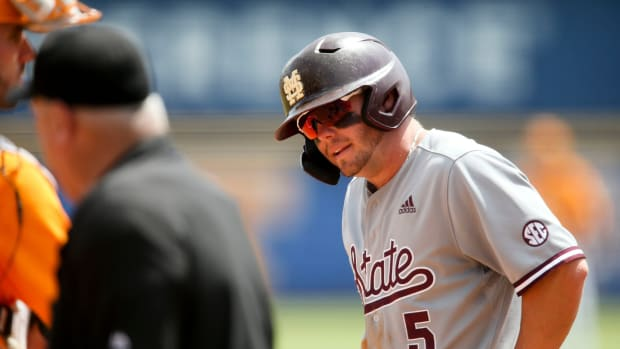 Mississippi State hitter Tanner Allen (5) takes an extra few minutes to recover after fouling a ball off his foot or ankle while batting against Tennessee during the SEC Tournament Thursday, May 27, 2021, in the Hoover Met in Hoover, Alabama. [Staff Photo/Gary Cosby Jr.] Sec Tournament Tennessee Vs Mississippi State