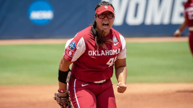 Jun 10, 2021; Oklahoma City, Oklahoma, USA; Oklahoma Sooners pitcher Giselle Juarez (45) reacts after a strike out against the Florida State Seminoles during the first inning during game three of the NCAA Womens College World Series Championship Series at USA Softball Hall of Fame Stadium.