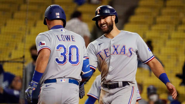 Jun 12, 2021; Los Angeles, California, USA; Texas Rangers center fielder Joey Gallo (13) is all smiles as he congratulates first baseman Nate Lowe (30) for his ninth inning home run against the Los Angeles Dodgers at Dodger Stadium.