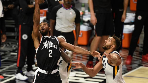 Jun 12, 2021; Los Angeles, California, USA; LA Clippers forward Kawhi Leonard (2) goes up for a shot in front of Utah Jazz center Rudy Gobert (27) in the third quarter during game three in the second round of the 2021 NBA Playoffs. at Staples Center. Mandatory Credit: Kelvin Kuo-USA TODAY Sports
