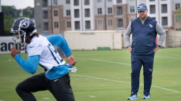 Titans general manager Jon Robinson watches wide receiver Josh Reynolds (18) during practice at Saint Thomas Sports Park Thursday, June 10, 2021 in Nashville, Tenn.